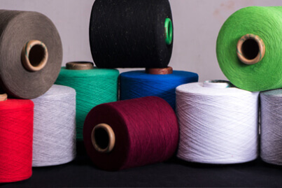 Collection of Sustainble Colored Yarn in Recylce Cotton, Polyester Blends